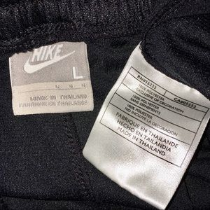 Nike Pants lightweight knit zip hems relaxed fit
